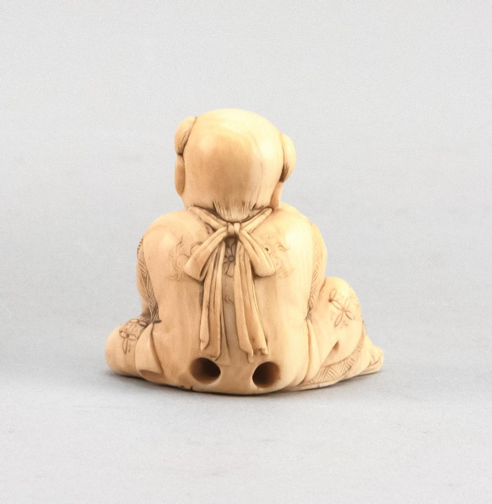 JAPANESE IVORY NETSUKE By Gyokuyosai Mitsuhina (1781-1868). In the form of a boy wrapping a cord around a turtle. Signed on base. He...