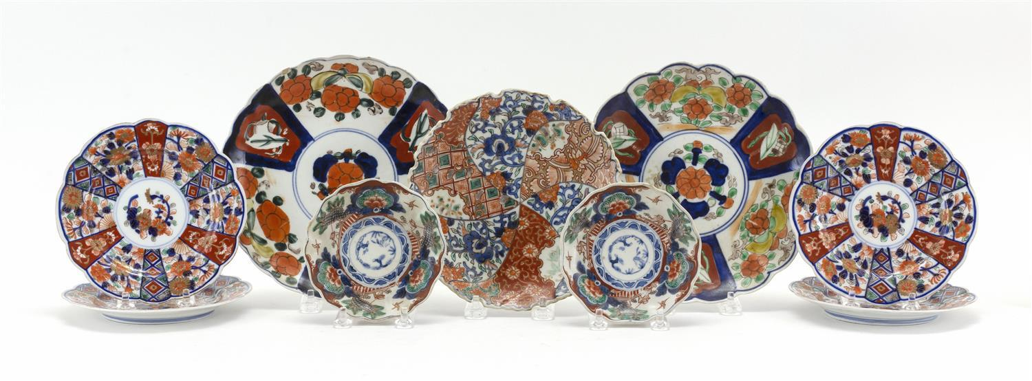 "NINE ASSORTED JAPANESE IMARI DISHES A pair of 4.75"" sauce dishes (one chipped), four 6.25"" floriform dishes, a 7.5"" dish in a pinwhe..."