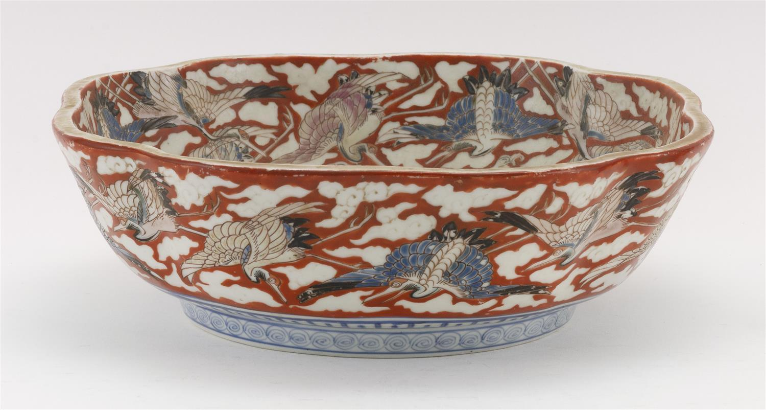 """JAPANESE IMARI PORCELAIN BOWL In mokko form, with decoration of a turtle and wave surrounded by a crane border. Diameter 11.5""""."""