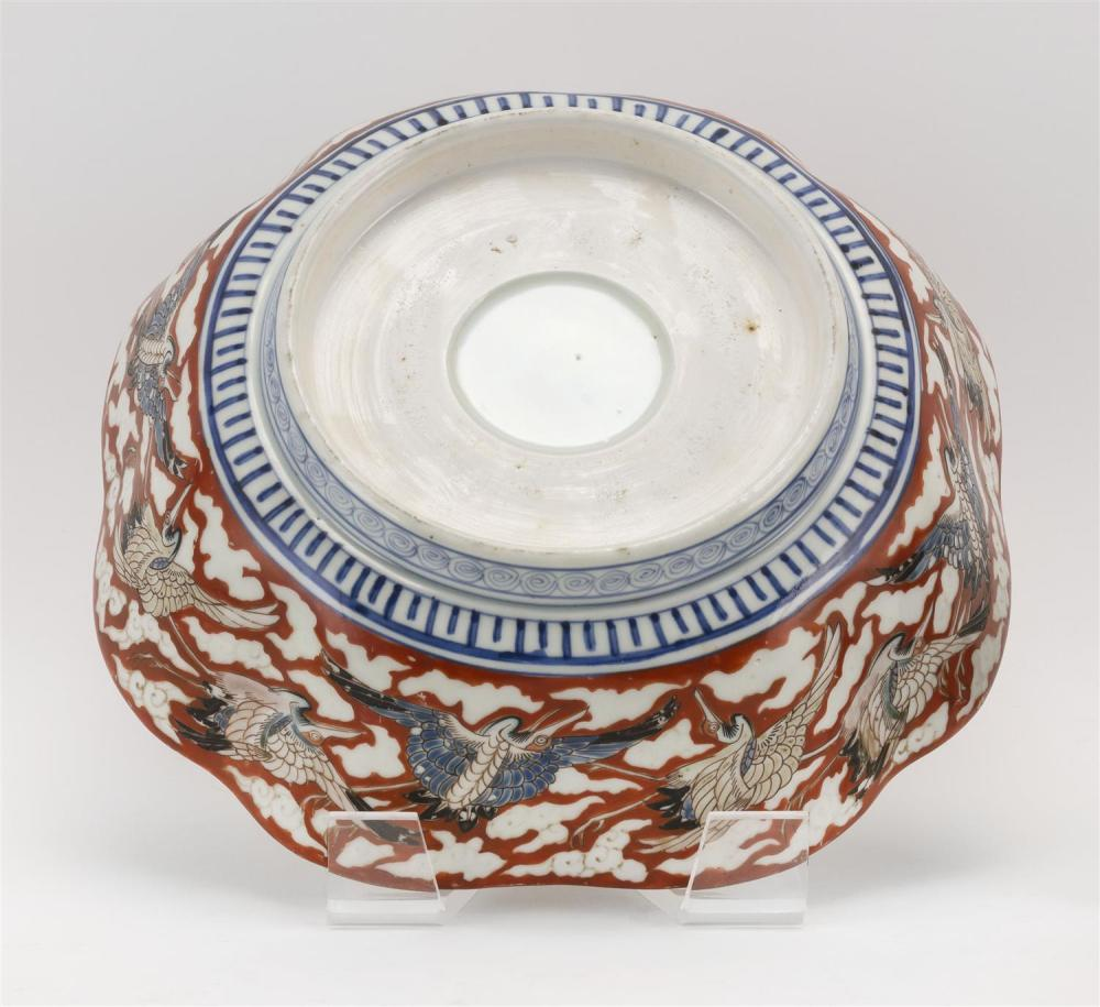 JAPANESE IMARI PORCELAIN BOWL In mokko form, with decoration of a turtle and wave surrounded by a crane border. Diameter 11.5