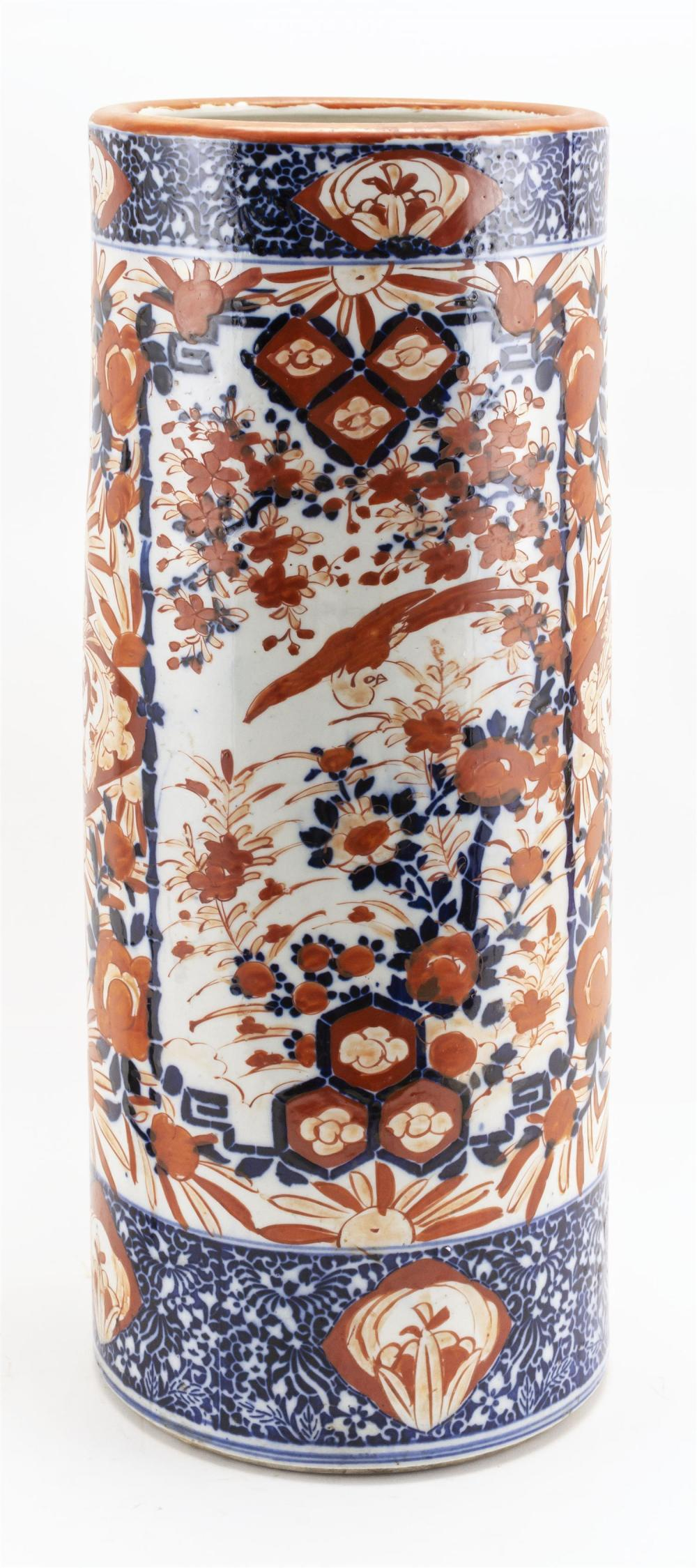"JAPANESE IMARI PORCELAIN UMBRELLA STAND Cylindrical, with a bird and floral design. Height 24.5""."