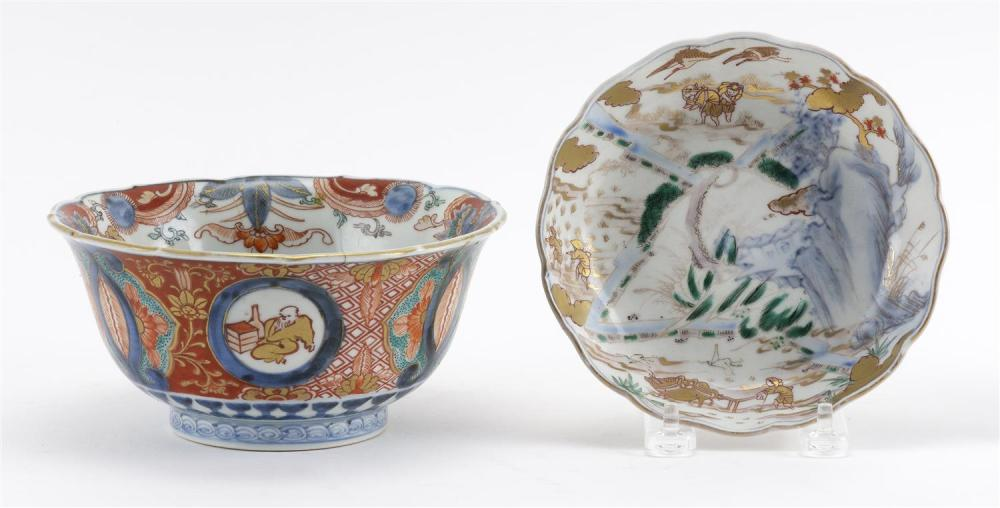 TWO JAPANESE IMARI PORCELAIN BOWLS 1) With a shaped rim, and figural and landscape cartouches on an underglaze blue and white ground...