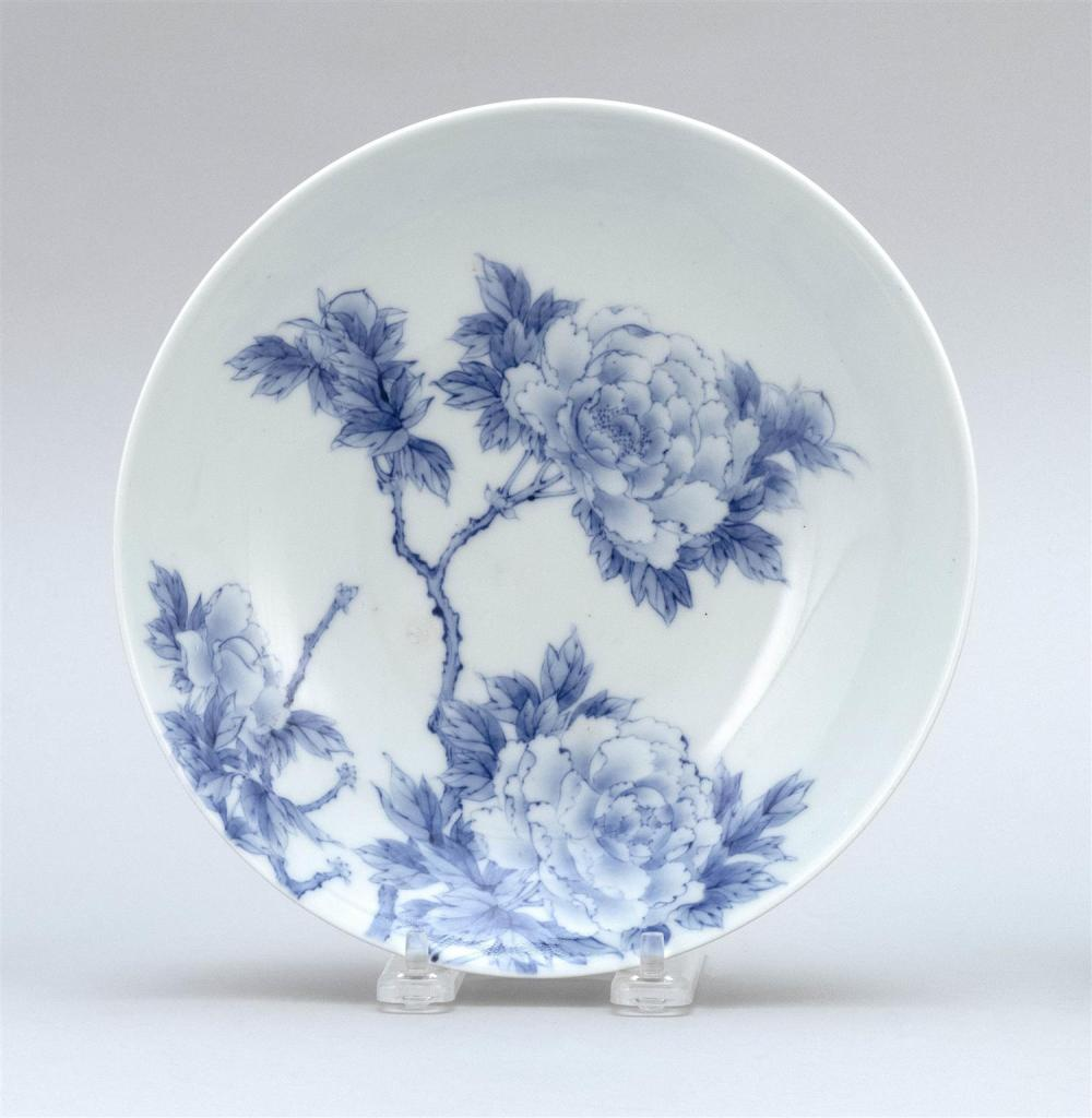 """JAPANESE BLUE AND WHITE NABESHIMA DISH Interior with peony design. Exterior with flower design and combed foot. Diameter 8.25""""."""