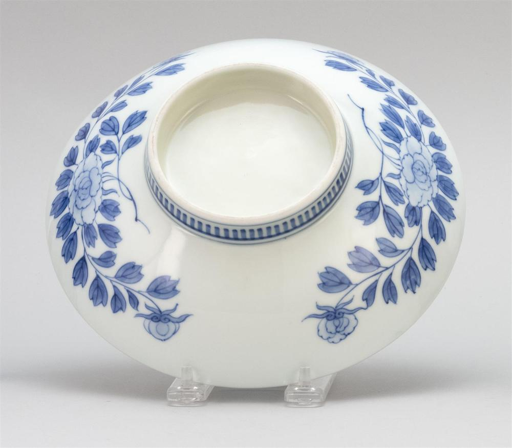 JAPANESE BLUE AND WHITE NABESHIMA DISH Interior with peony design. Exterior with flower design and combed foot. Diameter 8.25