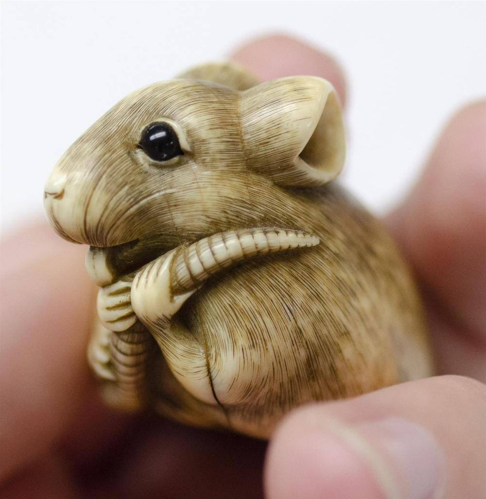 JAPANESE IVORY NETSUKE In the manner of Okatomo. In the form of a rat with inlaid horn eyes. Length 2