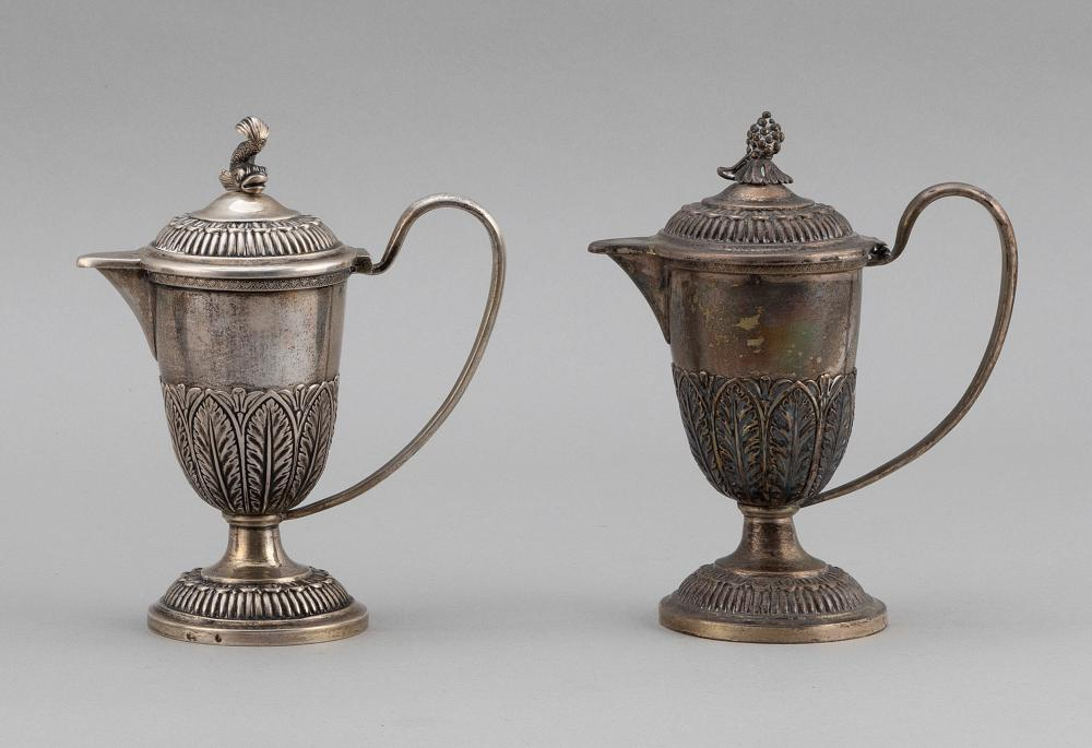 NEAR-PAIR OF AUSTRIAN SILVER COVERED JUGS Vienna, 1810-1886 Approx. 19.6 troy oz.