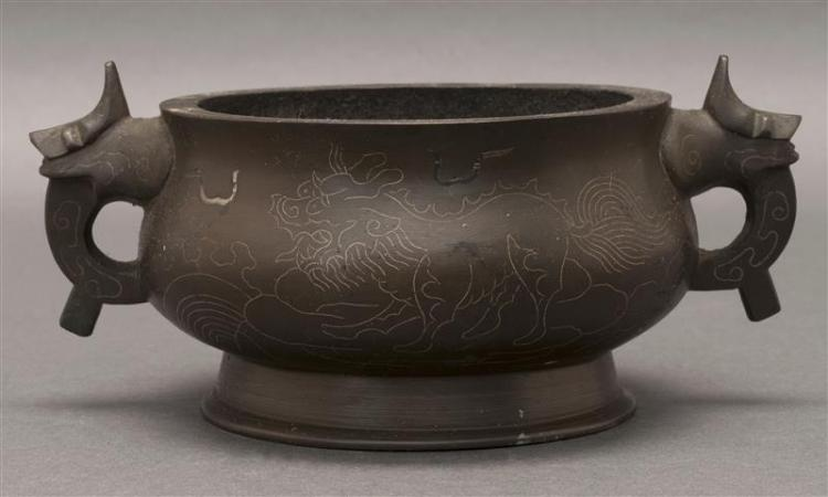 BRONZE CENSER In ovoid form with dragon''s-head handles and silver inlay depicting qilin. Dragon mark on base. Length 6.7