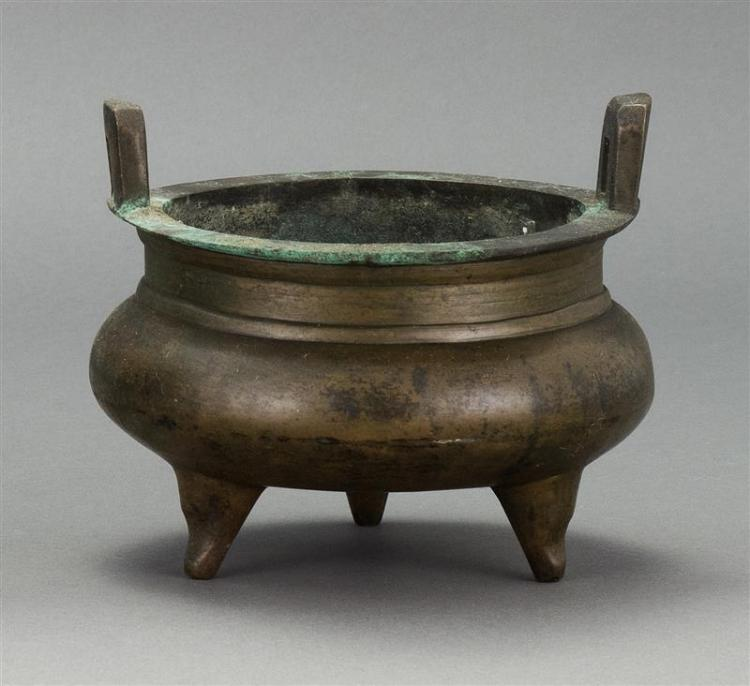 BRONZE CENSER In ovoid form with tripod base and rectangular handle. Six-character Ming mark on base. Diameter 6.1