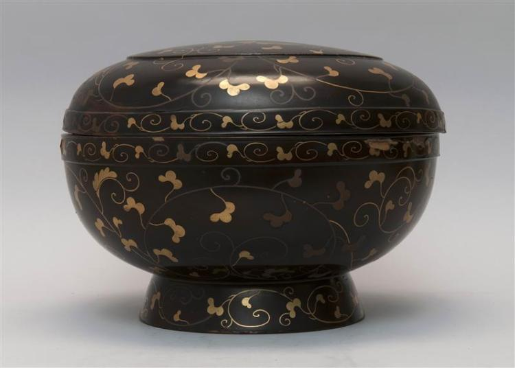 BLACK AND GOLD LACQUER COVERED BOX In ovoid form with karakusa design. Bamboo rondel mark on base. Diameter 14.5