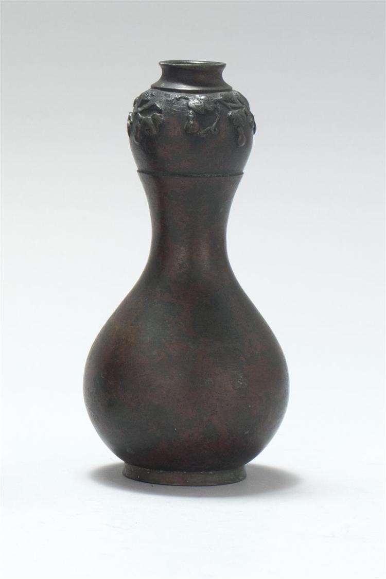 BRONZE VASE In double gourd form with relief gourd design. Height 6.7