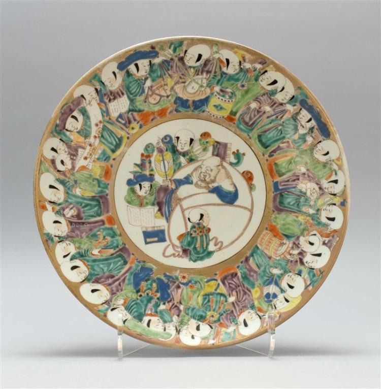 IMARI PORCELAIN CHARGER With central cartouche depicting Hotei and karako surrounded by a karako band. Underside with horse rondels....