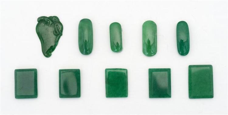 TEN PIECES OF IMPERIAL GREEN JADE Five in rectangular form, four oval, and one in fruit form. Lengths approximately .8