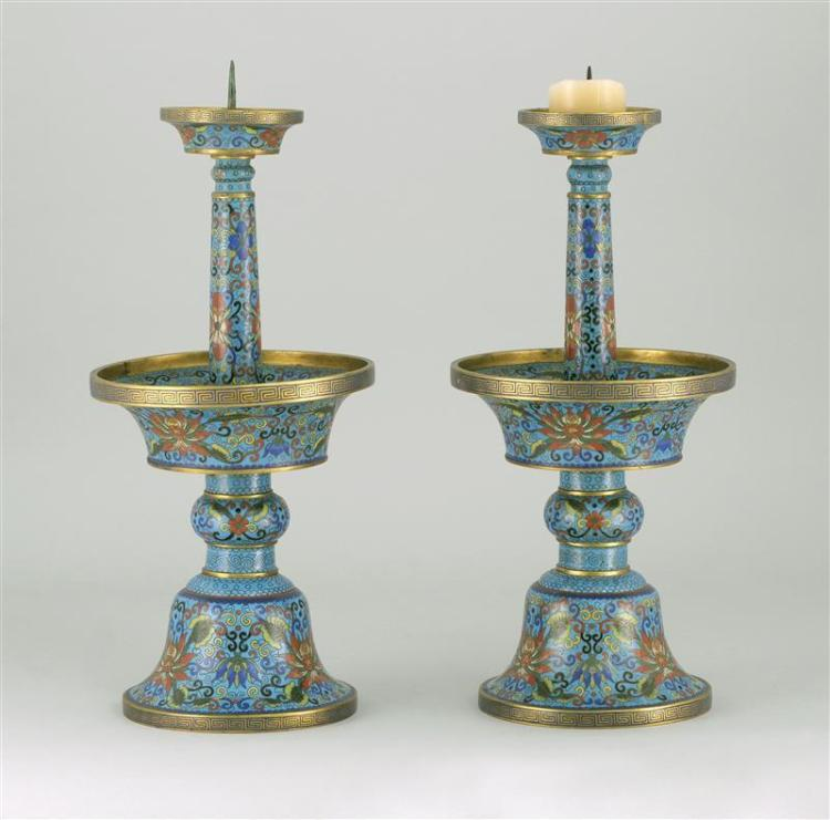 PAIR OF CLOISONNÉ ENAMEL PRICKET CANDLESTICKS In baluster form with bell-form base and decorated with passionflower design on a blue...