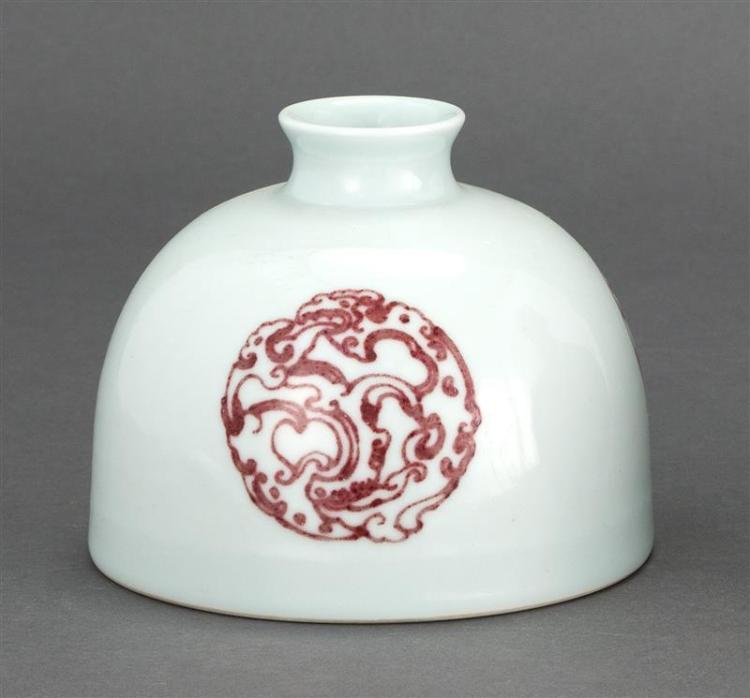 PORCELAIN WRITER''S COUPE In beehive form with underglaze red dragon rondel design. Six-character Kangxi mark on base. Diameter 5.3