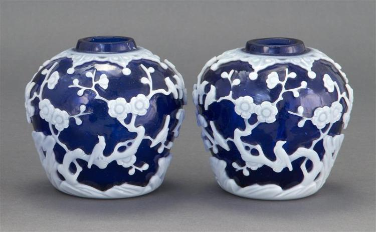 PAIR OF OVERLAY GLASS JARS In ovoid form with white floral landscape design on a cobalt blue ground. Height 5