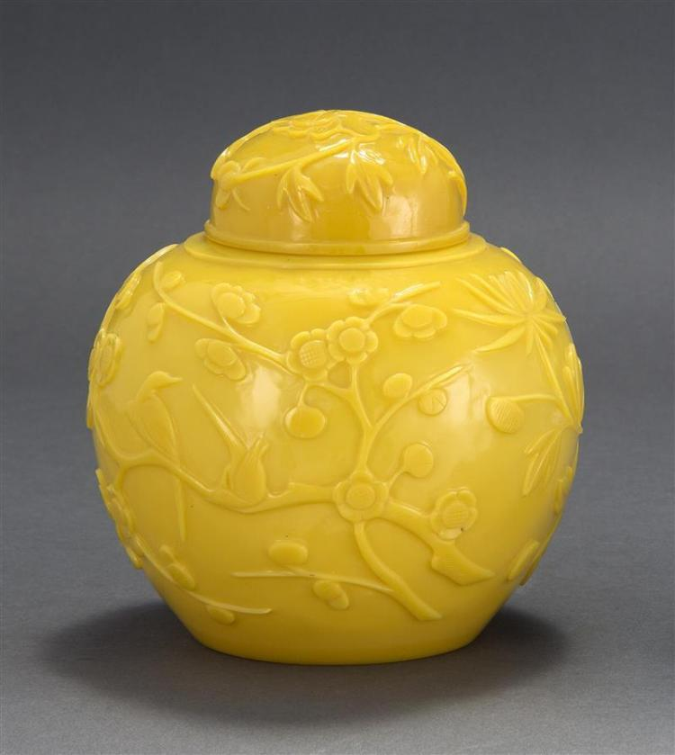 IMPERIAL YELLOW BEIJING GLASS COVERED JAR In ovoid form with relief bird and flower design. Original conforming cover. Height 7.2