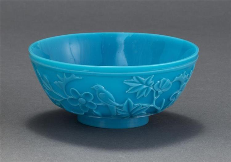 BEIJING GLASS BOWL In medium blue with bird and flowering tree design in relief. Diameter 5.75