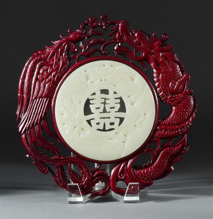 WOOD-FRAMED GLASS PLAQUE Plaque with dragon and phoenix carving about a Double Happiness symbol. Diameter 5