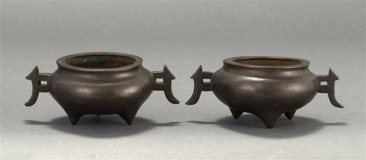 PAIR OF BRONZE CENSERS In ovoid form with silver wire cloud design. Two-character Shishou mark on base. Length 6