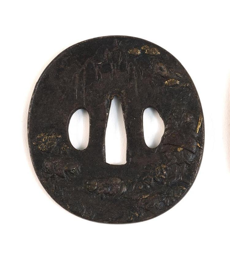 IRON SHIN NO MARU-GATA TSUBA With inlaid and relief decoration of figures in a stream. Length 3