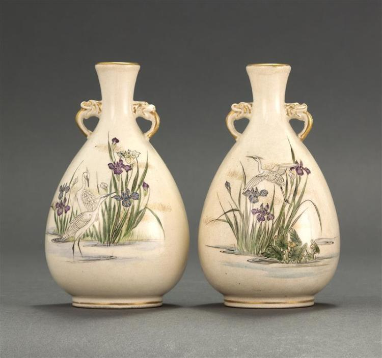 PAIR OF KINKOZAN PORCELAIN VASES In teardrop form with gilt animal-form handles. Bodies decorated with white egrets and purple irise...