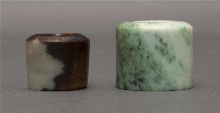 TWO JADE ARCHER''S RINGS One in celadon with mottled spinach-green skin area, height 1