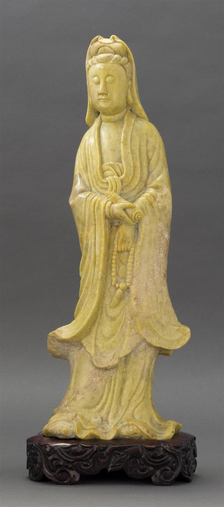 SOAPSTONE FIGURE OF GUANYIN In standing position holding prayer beads and scroll. Height 19
