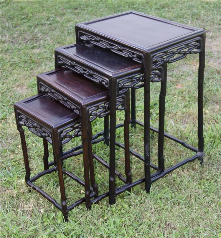 3SET OF FOUR ROSEWOOD NESTING TABLES With openwork aprons. Heights 20