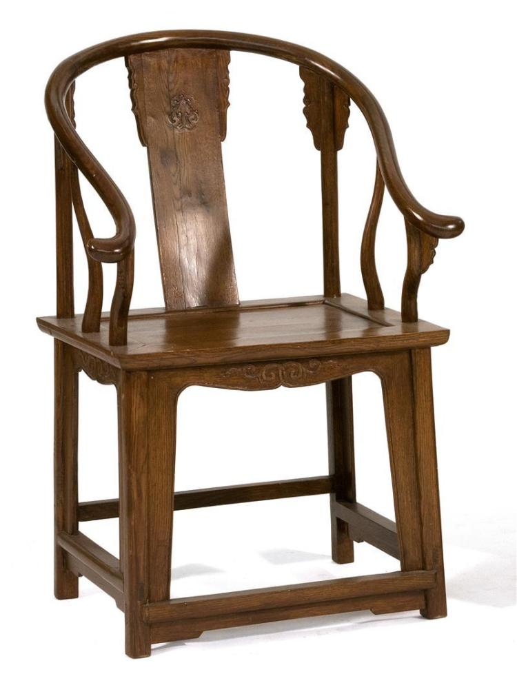 YOKE-BACK ELMWOOD ARMCHAIR With ruyi carving. Height 39.5