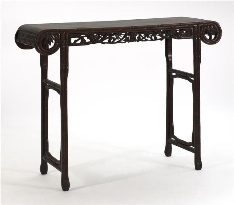 ROSEWOOD ALTAR TABLE With bamboo-style returns, lotus-carved apron, and bamboo-form legs. Height 40.5