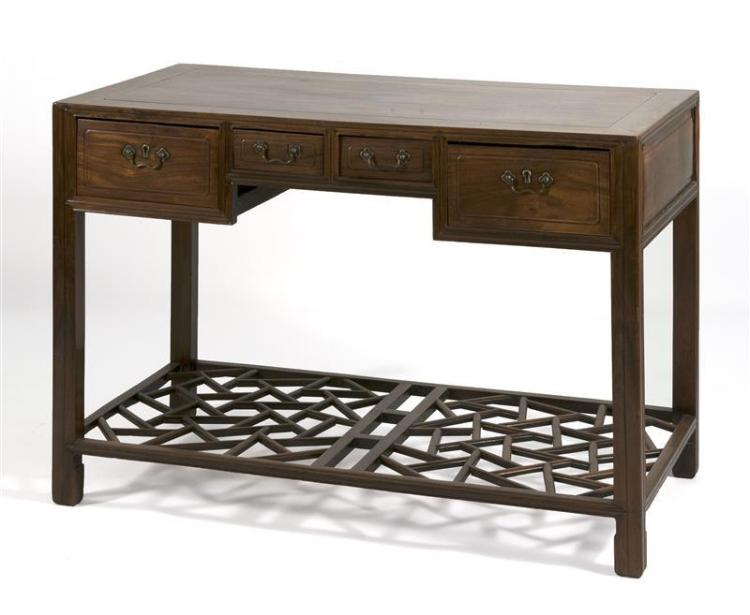HUANGHUALI DESK With four drawers, paneled sides, and a cracked-ice pattern foot rest. Height 32.75