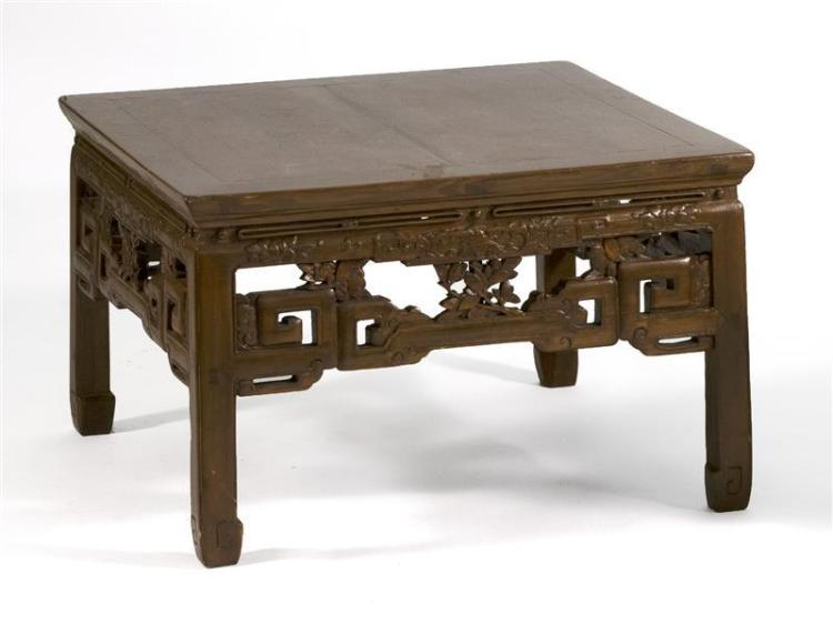 ELMWOOD LOW TABLE In square form with pierced peony and fret-carved apron. Height 17.5