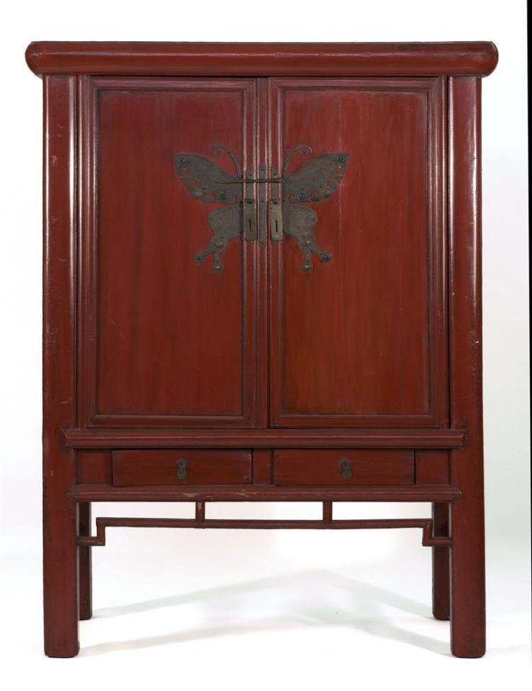 RED LACQUER BUTTERFLY CABINET With two paneled doors over two drawers. Engraved butterfly-form brass appliqué with glass inlay. Heig...