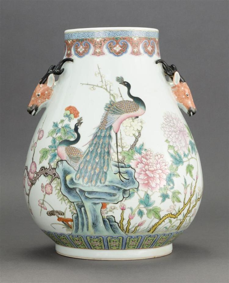 FAMILLE ROSE PORCELAIN VASE In ovoid form with deer-head handles and peacock, peony, and prunus decoration. Finely detailed lappet d...
