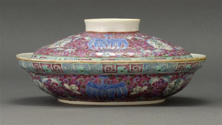 FAMILLE ROSE PORCELAIN COVERED VEGETABLE DISH With phoenix and flower design on a rose ground. Six-character Qianlong mark on base....