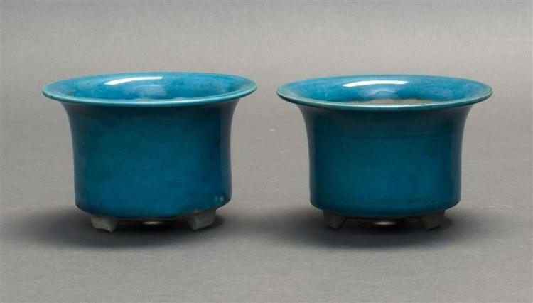PAIR OF MINIATURE POTTERY JARDINIÈRES In turquoise glaze with cylindrical body and slightly flared mouth. Tri-footed base. Heights 3