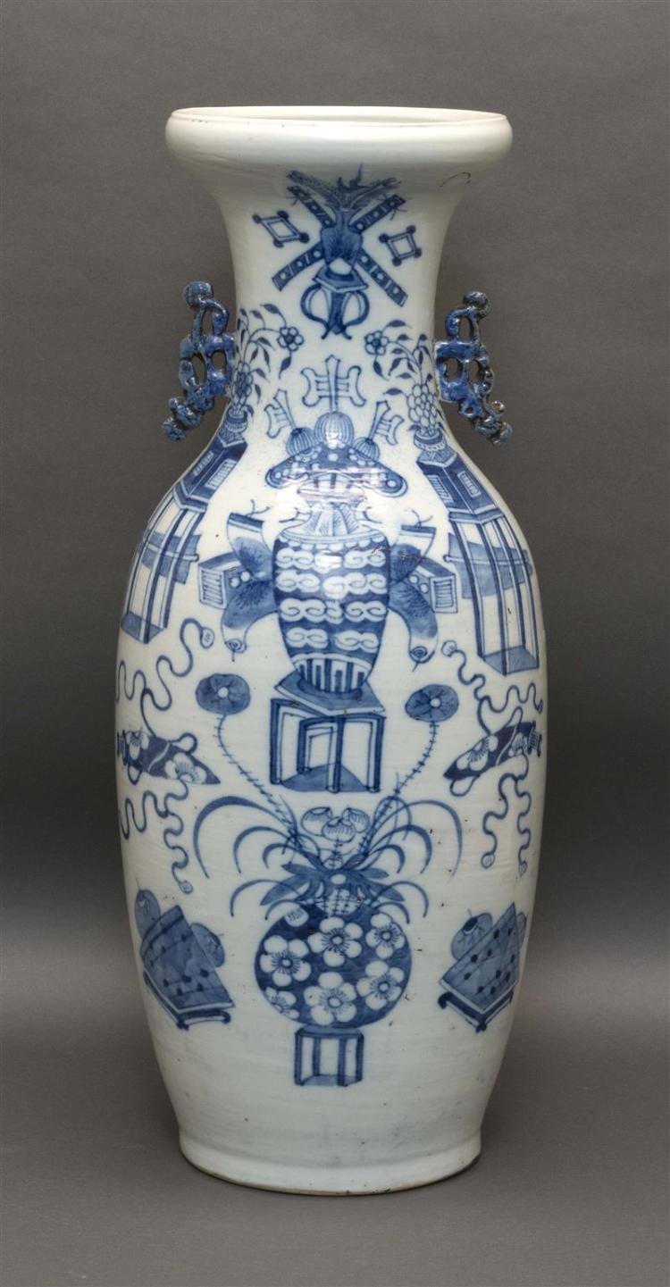 BLUE AND WHITE PORCELAIN VASE In rouleau form with key fret handles and decoration of vases full of flowers and implements. Height 23