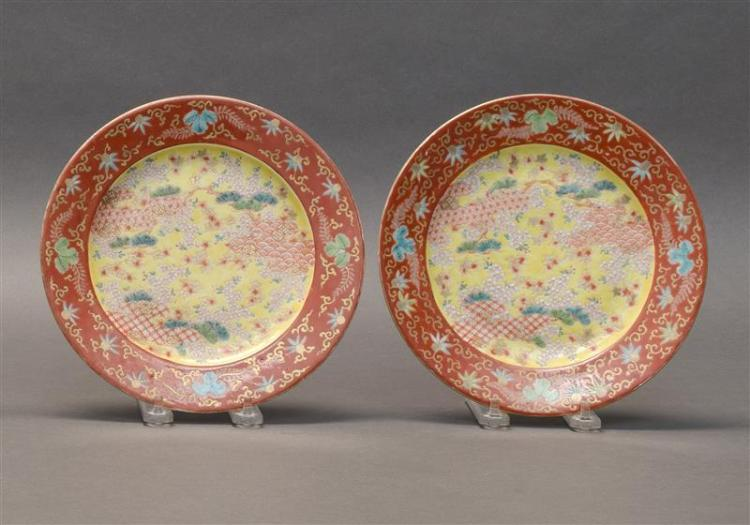 PAIR OF KORANSHA PORCELAIN DISHES With red and yellow paulownia and cherry blossom design. Diameters 8.25
