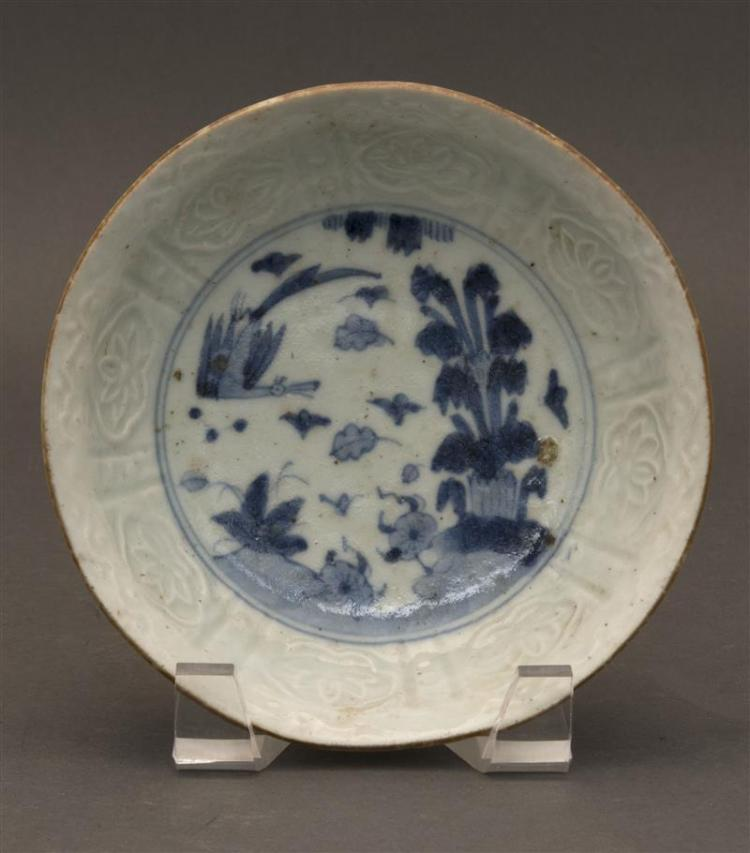 BLUE AND WHITE ARITA PORCELAIN BOWL With bird and bamboo design surrounded by carved lotus motif. Diameter 6