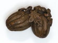 CARVED WOOD NETSUKE In the form of two gourds with relief leaves and vines. Length 2.2