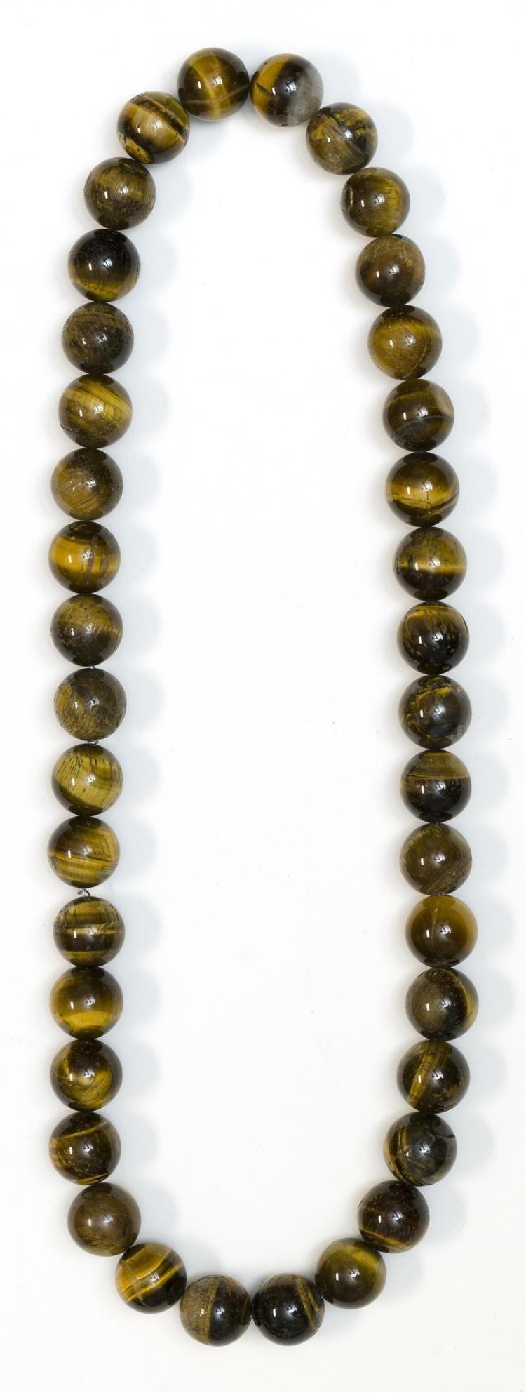 STRAND OF TIGER''S EYE BEADS Thirty-eight 17 mm beads.