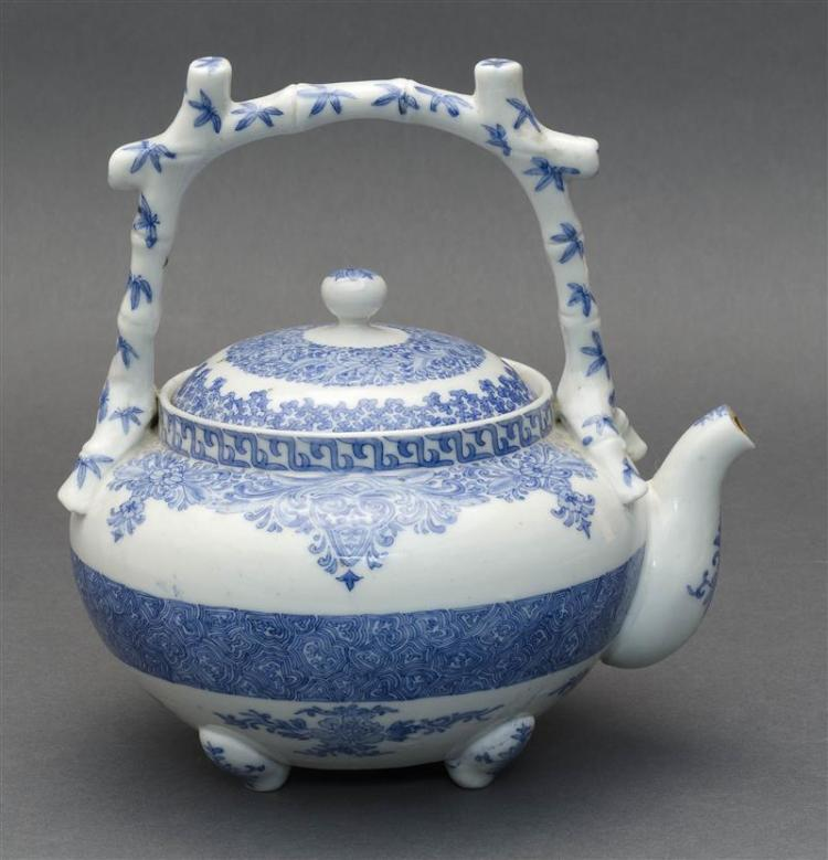 BLUE AND WHITE PORCELAIN TEAPOT With bamboo-design handle and floral decoration. Height 7.5