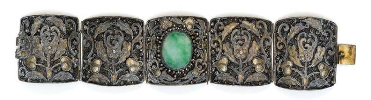 SILVER AND JADE BRACELET Formed as five links with floral filigree and gilt design. The central link mounted with oval green jade ca...