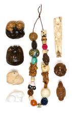 ASSORTMENT OF NETSUKE AND OJIME Including a bone figure of a sennin, a wood lion figure, ojime of various materials, etc.