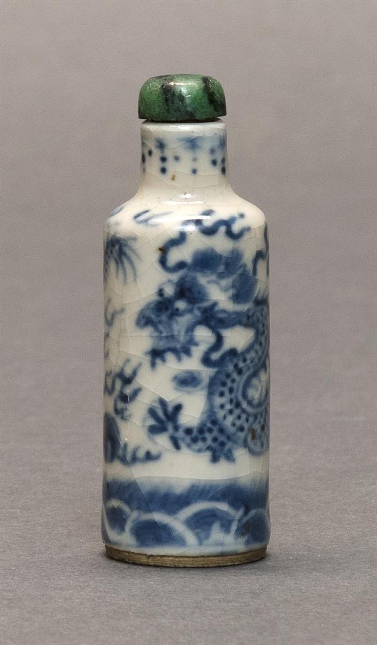 MINIATURE BLUE AND WHITE PORCELAIN SNUFF BOTTLE In cylinder form with five-claw dragon design. Height 2