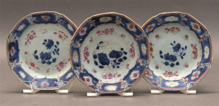 THREE PIECES OF UNDERGLAZE BLUE PORCELAIN Two dishes and a plate. Each with red and gilt enameled floral decoration over a blue and...