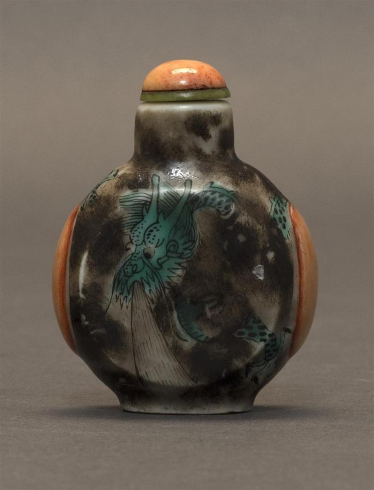 SMALL PORCELAIN SNUFF BOTTLE In pilgrim flask form. With green enameled dragon decoration on a mottled gray ground. Coral-colored mo...