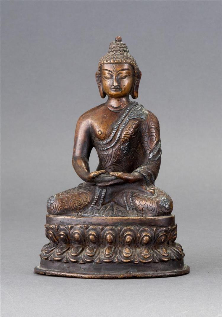 BRONZE FIGURE OF BUDDHA Dressed in a floral robe and seated in a meditation pose on a lotus throne. Incised lotus flower on base. He...