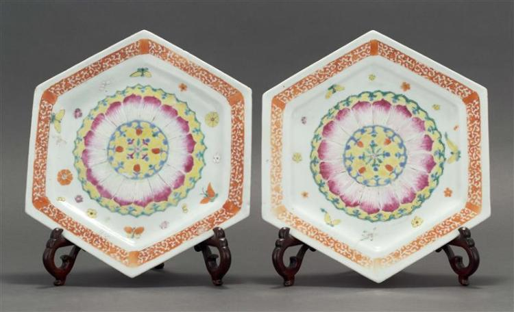 PAIR OF FAMILLE ROSE PORCELAIN PLATES In hexagonal form. With central pink lotus petals on a yellow ground surrounded by butterflies...