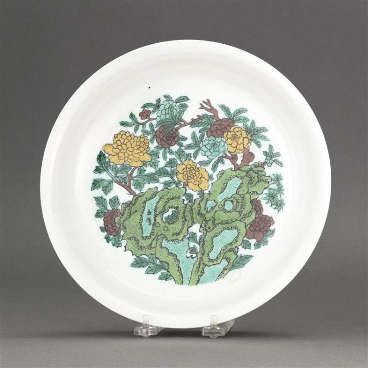 FIVE-COLOR PORCELAIN SHALLOW BOWL With peony and rockery design on a white ground incised with dragon motif. Six-character Kangxi ma...